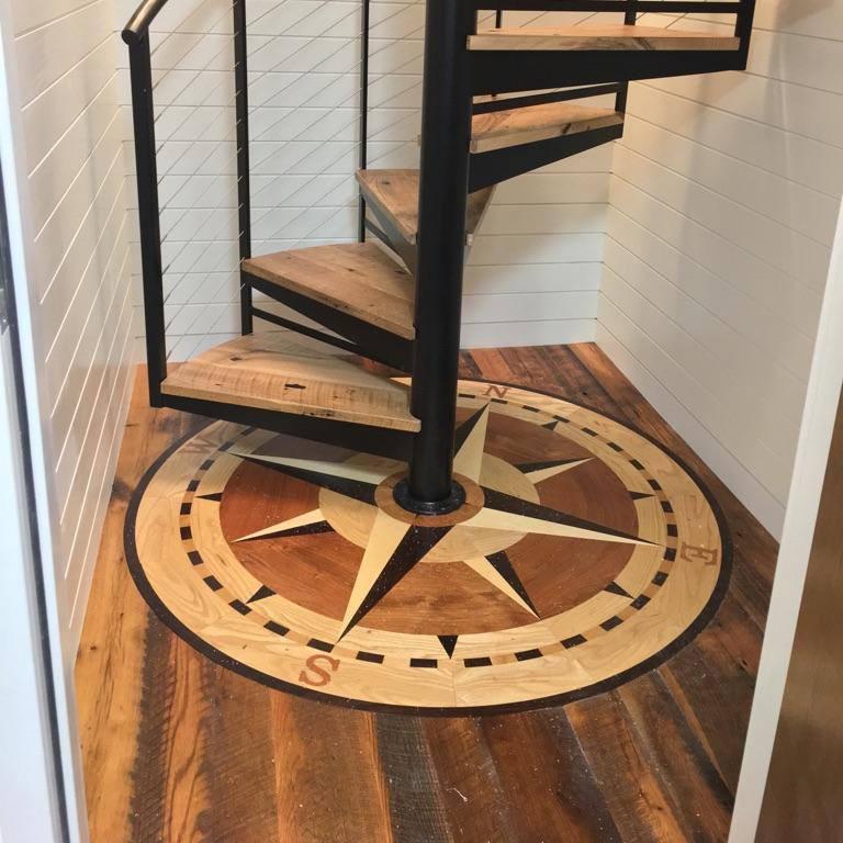Hardwood Inlay under Spiral Staircase